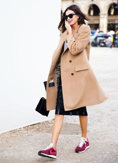Nude trench coat + black leather skirt + sneakers