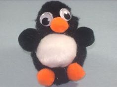 A make penguin out of pompoms for our Mr. Popper's Penguin unit. Making an ice box out of show box with a penguin inside:)