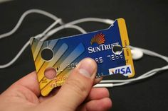How to turn an old credit card into an earbud holder.