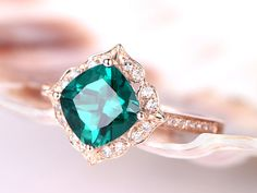 Emerald Engagement Ring,7mm Cushion Cut Emerald Wedding Ring,Diamond Band,14k yellow gold band,Art Deco Retro Vintage Floral,Bridal Ring  Main stone:7mm Cushion Cut 1.3ct  Lab-Treated Emerald Accent stone:0.135ct Round Cut SI-H Diamonds band width(bottom):1.29mm band  width(top):1.69mm bottom height:1.10mm top height:5.72  This ring in yellow gold: https://www.etsy.com/listing/278954026/cushion-7x7mm-emerald-ringdiamond?ref=shop_home_active_13  More style ring you .
