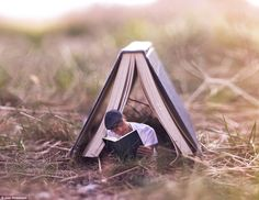 The Hideout: On a not so rainy day, tiny Joel reads a tiny book while in the shade of a giant one in the garden