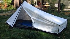 The Tarptent Sublite was an option. But someone informed me that it wasn't constructed to withstand strong rainfall. At $199 and 19.5 oz, it would have been a great choice, but heavy rain protection is required.