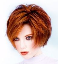 Love this cut and color is amazing...would love to see my sister go this dark!   Short Wavy Hair Style with Medium Length bangs, chin bob in layers, redish brown