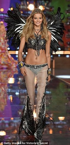 Russian Kate Grigorieva proudly flaunts her black and white wings at the Victoria's Secret 2015 spectacular