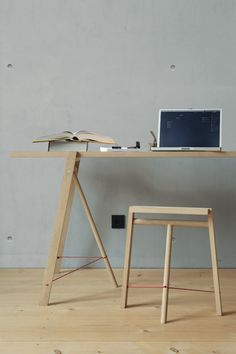 A three-legged family called 5°by Nils Holger Moorman. Trestles, high and low stool. The family has a third leg to stand on. If this leg is in place, a narrow seat is created. The two trestles easily support a tabletop, which can be used on both sides.