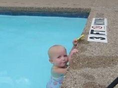 Adorable baby swims across pool
