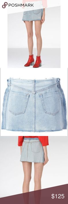 MM6 by Maison Martin Margiela Denim Mini Skirt Denim skirt crafted in a denim elaborated with a bleach effect. It features raw edges and a mini-length as well as two patch pockets on the front. On the back, the skirt is treated with a different bleach with visible topstitching giving the illusion of bringing the inside outside. Made In Italy. Worn a couple times but in great condition. MM6 Maison Martin Margiela Skirts Mini
