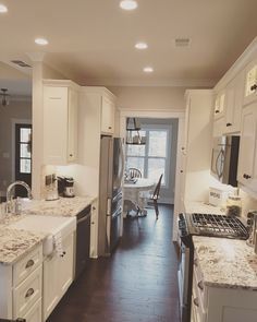 Neutral kitchen from The Runnymeade #1164. http://www.dongardner.com/house-plan/1164/the-runnymeade. #Kitchen #OneStoryHouses #Small