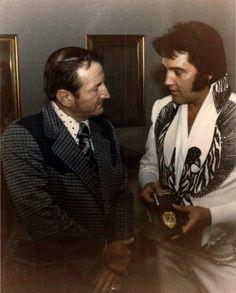 Elvis with Chief Sweeton in Huntsville, AL, receiving another badge, on June 1, 1975