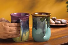 Clay in Motion Pottery's hand warmer mugs... I wonder if I could get these in black and ivory... if not, purple please!!! :)
