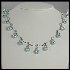 Amazon.com: Dangling Blue Pearl, Silver and Crystal necklace (Light Blue): Jewelry
