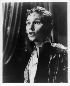Brandon deWilde stands in the rain in a scene from the film 'All Fall Down' 1962