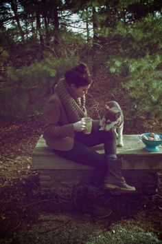 Love everything about this picture..oversized scarf, comfy warm cardigan, jeans, the nature..that husky puppy!! <3