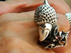 This mind blowing ring is the head of an eagle with a talon connected to a small stone.