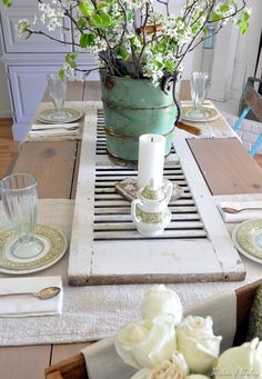love the mint green pail and the shutter on this tablescape.  Just my style.