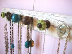 use a 2x4 (super inexpensive) and place a bunch of knobs for jewelry holders - you can get really colorful and creative with the different types of knobs you can find. there are some really great knobs at anthropologie as well.