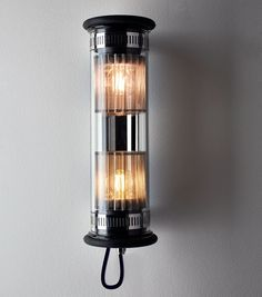 dominique perrault adds signature mesh to in the tube lamp collection
