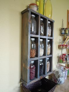Ball Jar Storage - We use ball jars to store everything, but they're kind of a pain to store in a cabinet and take up a lot of space. Voila! Display the more interesting textures, and they're quick to grab and remind you to eat the healthy things in your cabinet! Inspired by another post on Pinterest that used fiberboard, this is cedar painted to look aged