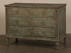 Louis XVI period oak chest of drawers from France c.1780 with a painted and gilded finish.