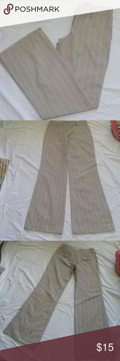 Development tan pin striped slacks Gently used pin striped straight leg slacks. Single button and hook enclosure. Two side pockets and 2 buttoned flap pockets in the back.  Light weight material, which is6 60% vscose 40% cotton.  Machine washable.  In excellent condition. development Pants Trousers