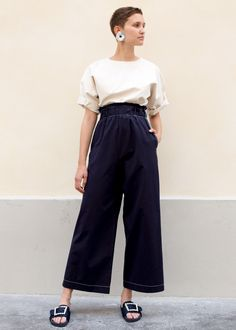 "Wide Leg, Cropped Pant w/White Stitched Trim.  Elastic Waist, 2 Side Pockets  100% Cotton 25"" Inseam Length, Approx 25-27"" Stretch Waist, 16"" Rise Dry Clean  By The Open Product. Imported"