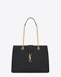 Classic Saint Laurent shopper tote with metal chain, leather double handles and interlocking YSL signature buckle closure.