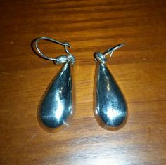 .925 Mexico Sterling Silver Earrings This pair of teardrop earrings are marked. 925 TP-22 MEXICO.  They are heavy so I believe they are solid Silver.  The TP is probably the maker's initials,  but I'm not sure what the 22 means.  The earrings are just over 1 inch long. Jewelry Earrings