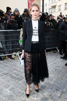 Olivia Palermo attended Dior Haute Couture showing off an unexpected styling trick with black tights—see it here.