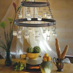 Baby food jar Chandelier-This chandelier has all the charm of medieval ironwork—but it comes from the recycling bin. Used baby-food jars, a few yards of twisted wire, a couple repurposed barrel hoops and a length of rusty chain are all it takes to spark images of exotic locales. Powered by votive candles, the chandelier crackles with energy without drawing a single watt.