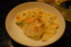 Creamy Chicken Casserole- 2 cups cooked chicken, 1 can cr chick soup, 1 cup shred cheddar, 16 oz mixed veggies, 1/2 cup sour cream. Mix & put in 8x8 casserole. Mix 1c bisquick, 1/4 cup sour cream w/3 Tbsp milk to make bisquits. Drop on top, bake 375 on bottom rack till browned