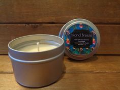 Pure beeswax scented candle in tin jar.