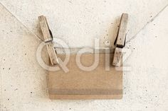 Qdiz Stock Photos | Clothespins holding greeting blank craft paper card,  #background #blank #brown #card #clear #closeup #clothesline #clothespin #craft #decoration #decorative #empty #greeting #holding #holiday #paper #pin #plaster #rope #small
