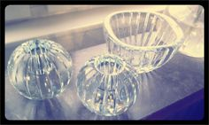 Glass bowl with candle holders.