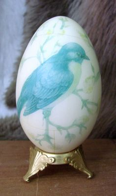 VINTAGE HAND PAINTED EGG ON GOLD METAL STAND  BEAUTIFUL HAND PAINTED BLUE BIRD WITH SOFT YELLOW FLOWERS  UNIQUE HAND PAINTED EGG DATED 1982 AND