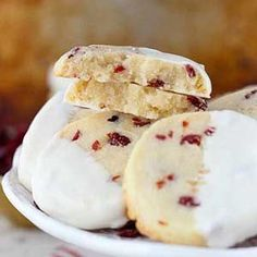 Shortbread cookies made with cranberries and almond extract and dipped in white chocolate make the perfect holiday -- or any day -- treat.