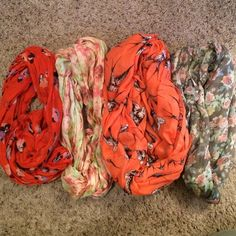 """Scarf haul (4) - Super fun designs! EUC I have 30+ scarves and certainly don't need that many (especially in Florida) So - here are four totally cute ones from my collection all from various places. The red/orange with navy flowers is 76"""". The pink/green floral is an infinity and measures 27"""" top to bottom. The coral with birds is a larger/fuller infinity measuring 40"""" top to bottom. The gray with pink/blue/green flowers is std scarf measuring 70"""". Accessories Scarves & Wraps"""