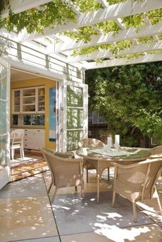 pergola with greenery over the patio and open French doors. My goals eventually for the back of our house. I want the pergola attached to the house- similar to this not white though Patio Pergola, Pergola Shade, Backyard Patio, White Pergola, Cheap Pergola, Rustic Pergola, Modern Pergola, Patio Trellis, Screened Patio