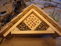 Home-made Insect Hotel from repurposed materials. Bee Cosy Bug House for happy Mason bees
