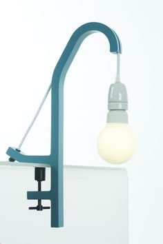 Clamp lamp for shelves or tables. The O10 Clamp Lamp is made with wood and has a textile cable and a porcelain socket. #clamplamp #interiorlighting
