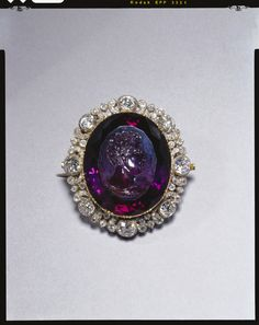 Rundell Bridge & Rundell - Brooch with an intaglio of George IV May be identifiable with the 'large Amethyst set with diamonds with George the Fourth's head engraved upon it' bequeathed by Princess Mary Duchess of Gloucester to Augusta Duchess of Cambridge in 1857. May therefore have entered the Royal Collection through Queen Mary, granddaughter of the Duchess of Cambridge.