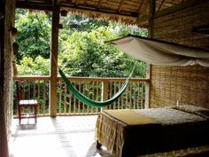 Amazon eco lodge Tambopata, Peru. Listen to the sounds of monkeys as the sun kisses your face when you awaken in this beautiful open-air lodge.