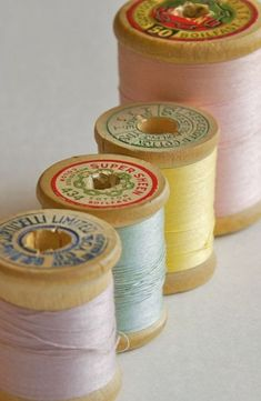 vintage spools of thread in pastel shades, wooden spools My Sewing Room, Sewing Box, Sewing Tools, Vintage Sewing Notions, Vintage Sewing Machines, Thread Spools, Needle And Thread, Little Mercerie, Sewing Baskets