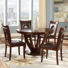 This Miraval 5-piece dining set provides elegant contemporary styling that is perfect for your dining room. The round table features both a rich wooden top with a curved finish base, complete with matching hole-back chairs for an open, airy feel.