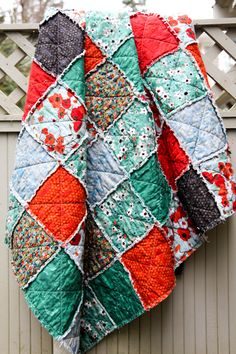 I LOVE this. It's been sold, but the fabric is available online! Red and Teal and Black Poppies Gallery Large Throw Rag Quilt.