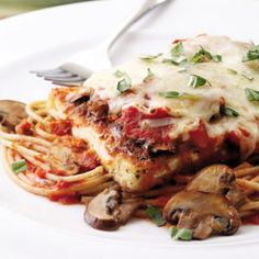 """Instead of having a greasy, battered coating, the tofu """"steaks"""" in our revamped Parmigiana are breaded and lightly pan-fried in just a small amount of oil then topped with part-skim mozzarella, fresh basil and your favorite marinara sauce. This Italian classic will please even those who are tofu-phobic."""