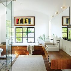 petrified wood tiles + white walls + warm wood in nature-inspired bathroom by Cisco Pinedo