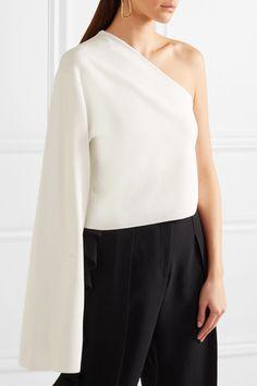 Ivory stretch-knit Slips on 56% viscose, 42% polyamide, 2% elastane Hand wash