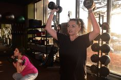 Kat Zeman, right, works out by contestant Deanna Bec during boot camp.