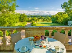 Breakfast on the terrace facing the mounts of Ardeche at Château de Potelières - Between Provence and Cevennes Luxury Holiday and Wedding Reception Venue