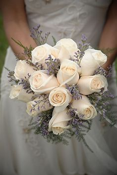 Soft cream Roses with Limonium Misty Blue make for a simple, yet elegant bouquet. Shop Roses, Limonium Misty Blue, and other popular wedding flowers year-round at GrowersBox.com.
